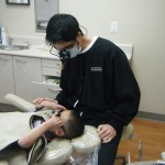 dentist with patient - Crown Dentistry in Sacramento