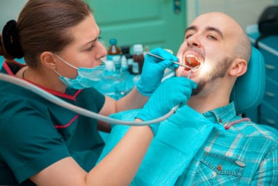 man getting dental cleaning